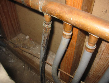 Hot water heating piping leakage